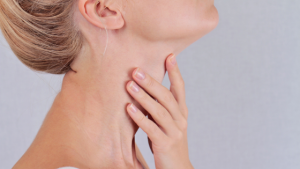 woman holding thyroid